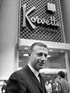 Eugene Ferkauf, owner of E. J. Korvette department store, standing outside by storefront on Fifth Avenue