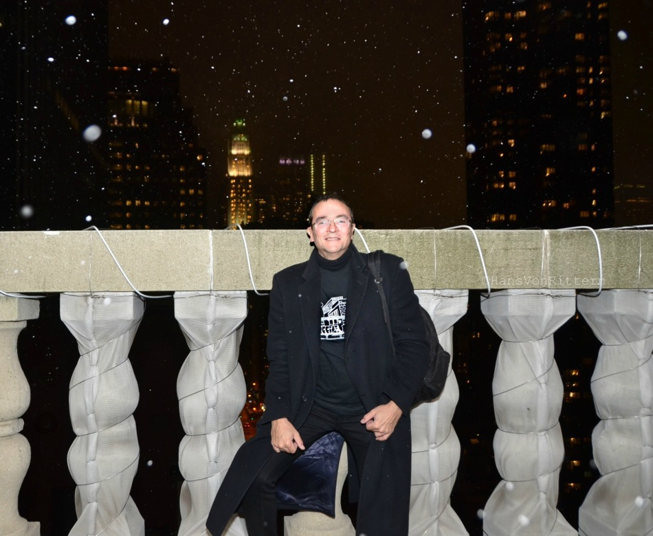 Atop the Clock Tower Gallery with the Woolworth Building in the background.