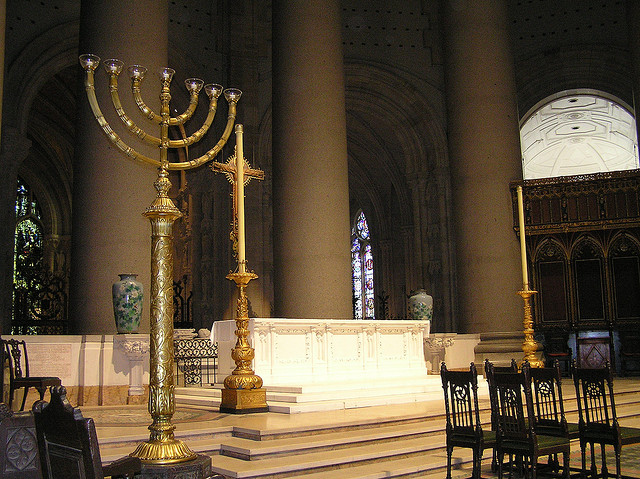 The menorahs on the altar of Episcopalian cathedral St. John the Divne Cathedral, NYC.